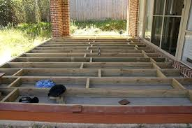 wood deck over concrete building a deck over concrete slab wooden deck vs concrete patio cost
