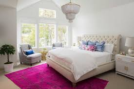 cream tufted sleigh headboard with hot pink overdyed rug