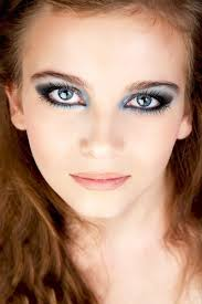 extremely deep blue eyes with a gorgeous dark blue grey and black make up