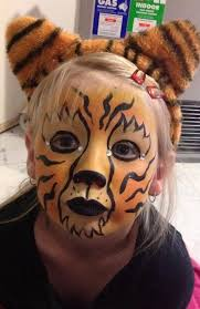 cute tiger create a face painting in under 5 minutes using face paint paintbrushes