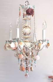 best 25 beach chandelier ideas on beach lighting beach style lighting and coastal inspired blue bathrooms