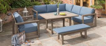 ezra corner set from kettler s casual dinng garden furniture range on a stoned patio