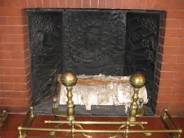 decorative fireback in a fireplace at 37 lancaster street