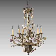 french six arm bronze chandelier fitted with porcelain flowers basket form