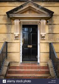 front door stepsBlack front door or ornate Victorian entrance with steps in Stock