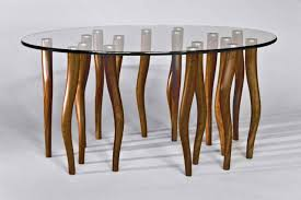 organic contemporary coffee table made from solid walnut wood and elliptical glass with stainless steel