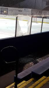 a pane in the glass hockey game cancelled due to powerful shot