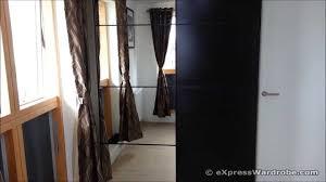 ikea pax ilseng black brown sliding door wardrobe design