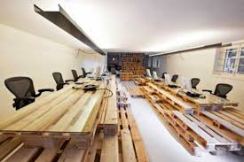 shipping pallets are low cost ways to build walls desks tables shelves and seating take it from most architecture who designed the interiors for amazing build office