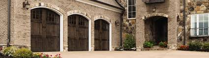 custom wood garage door with custom stain arched find more beautiful and elegant wood garage doors at precision door of los angeles