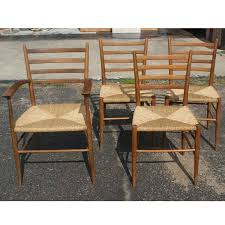 a set of four chairs gio ponti style 3 armless chair and 1 arm chair made in italy wood frame woven rush seat