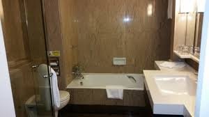 orchard hotel singapore our bathroom with bathtub and standing shower
