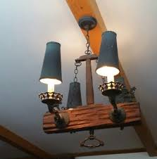 vintage goth hanging chandelier lamp with cast iron dragons barn wood beam