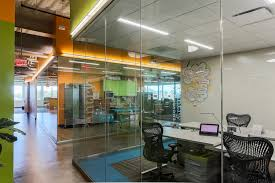contemporary office lighting. Sleight Illuminates A Glass Office Space In Contemporary Workplace For Linear, Rhythmic Lighting E