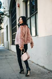 one of my favorite styles that i never get tired of wearing in winter is faux fur my must have item to brave the cold i saw a vintage fur coat at a