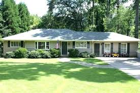 Painted brick exterior Pros Paint Brick House Cost To Paint Brick House Home Decorating Design Exterior Paint Schemes For Brick Paint Brick House Gray Painted Brick Exterior Plank And Pillow Paint Brick House Excellent Painting Brick House Exterior Painted