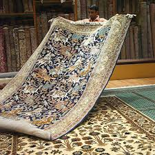 a rug is a textile floor covering typically consisting of an upper layer of pile attached to a backing the pile was traditionally made from wool but