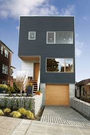 classy color combination the blue with the pine tone wood understated narrow lot homes