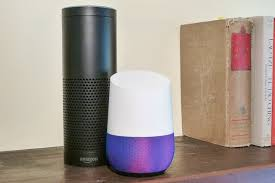perfect office google home. amazon echo and google home next to each other on a wooden shelf perfect office