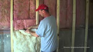How To Install Fiberglass Batt Insulation  Vapor Barrier YouTube - Insulating block walls exterior