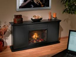 simply electric fireplace insert with black frame and chandelier in wooden floor for home ideas
