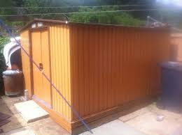 corrugated metal garden shed approx 8ft by 8ft it has double sliding doors to access inside