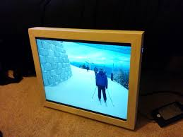 the creator of this project a aday reader greg also added a wireless remote to turn the picture frame from photo display to weather display mode