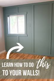 blue green floor to ceiling board and batten wall with window and text overlay that says