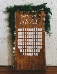 Picture Of A Wooden Board With A Geometric Seating Chart A