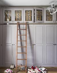 Overhead Storage Bedroom Furniture Grey Bedroom With Built In Wardrobe And Parquet Flooring The