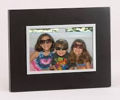 black wood picture frame with silver inner border holds 5 x 7 photo