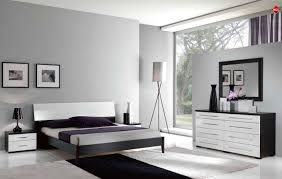 white room with black furniture. black and white bedroom furniture or raya designs room with o