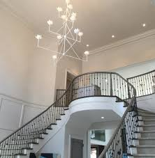 this photo was taken before the room was finished but even then the julie neill go chandelier was the star of the show