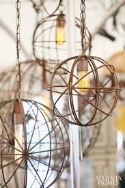 these industrial chic ball chandeliers are an easy way to add texture and character