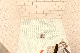how to retile a shower re tiling bathroom floor for best step rip up more area how to retile a shower