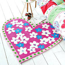 heart shaped rug this heart shaped rug is hand tufted with a wool pile which will heart shaped rug