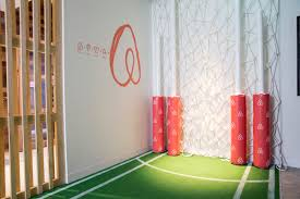 airbnb sydney office. everything in the front entrance is afl based as part of their partnership with sydney swans airbnb office g