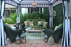i ve had such a blast decorating it starting with the green and white outdoor zebra rug also from z gallerie which i layered over an outdoor seagrass rug