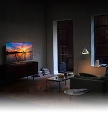 kids watching tv at night. qled tv has been set in the living room early evening and on its kids watching tv at night