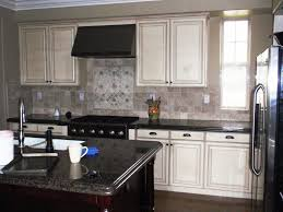 image of spray painting kitchen cabinets white