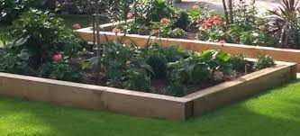 a raised bed with railway sleepers