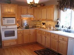 image of maple cabinets white appliances light granite countertops