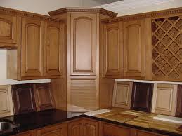brown wooden corner kitchen cabinet with doors complete with bottle wine racks and black granite countertop