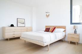simple bed  modern platform bed with brass feet  kalon studios us