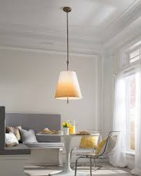 pendant light above a dining room table