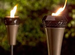 diy tiki torches light your garden