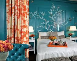 The orange and blue colors in the space are complementary. It creates a  warm and also cooling feel to the room. The dominant cool, blue color makes  the room ...