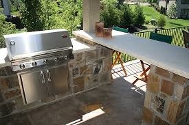 stone outdoor kitchen stone column limestone countertop cedar pergola built in stainless