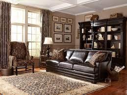 dark brown leather sofa with nailhead