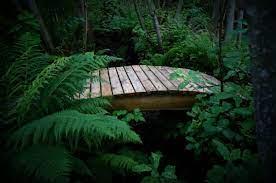 diy how to make a curved garden bridge